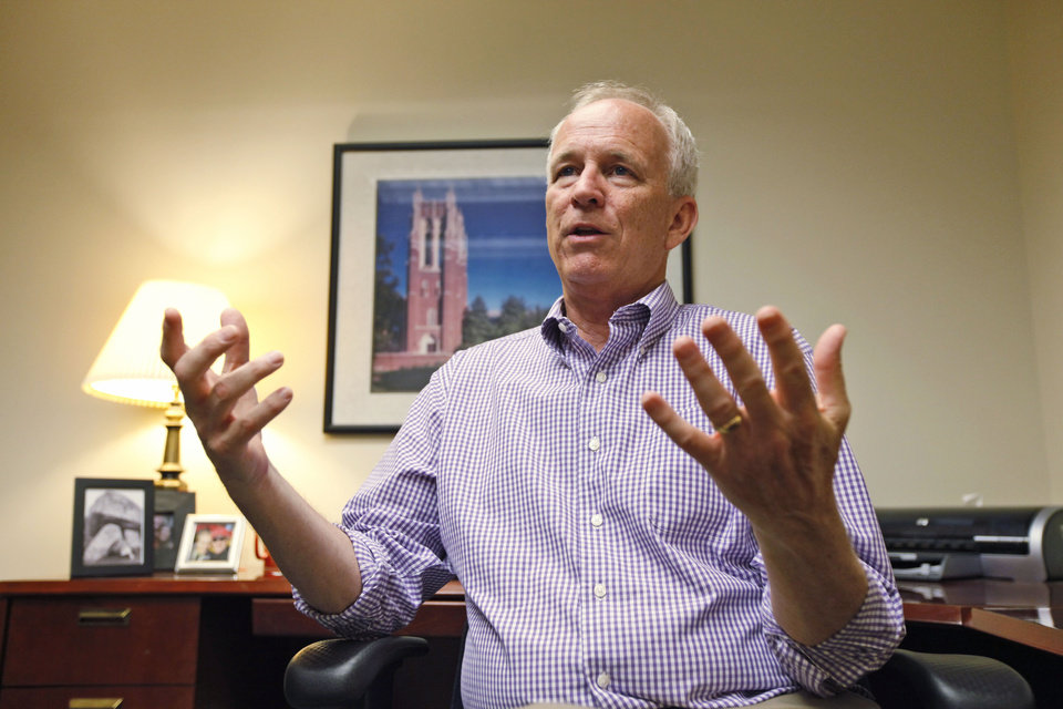Photo -   In this photo taken Monday, May 7, 2012, University of Richmond Athletic Director Jim Miller gestures during an interview in his office at the school in Richmond, Va. (AP Photo/Steve Helber)