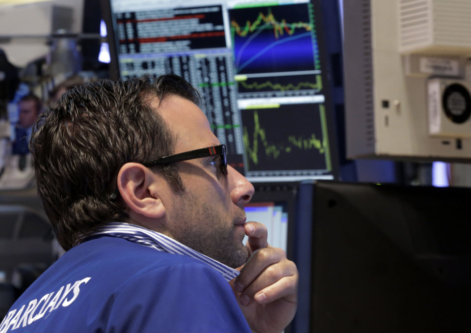 Photo - Specialist Michael Pistillo works on the floor of the New York Stock Exchange Monday, July 22, 2013. The stock market is opening mixed after McDonald's reported poor quarterly earnings. (AP Photo/Richard Drew)