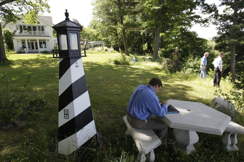 Photo -   A Law enforcement officer takes notes at the home of Dr. Timothy Jorden in Hamburg, N.Y., Thursday, June 14, 2012. Jorden is sought in connection with the hospital shooting death of his ex-girlfriend at Erie County Medical Center in Buffalo, N.Y. on Wednesday. (AP Photo/David Duprey)
