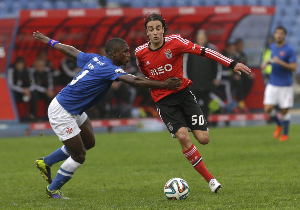 Photo - Benfica's Lazar Markovic, right, is grabbed by Belenenses Kay Graca during their Portuguese league soccer match Sunday, March 2 2014, at Belenenses' Restelo stadium in Lisbon. (AP Photo/Armando Franca)