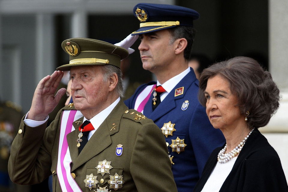 Photo - FILE - In this Monday, Jan. 6, 2014, file photo, Spain's Crown Prince Felipe, centre, Spain's King Juan Carlos, left, and Spain's Queen Sofia, right, attend the annual Pascua Militar Epiphany ceremony at the Royal Palace in Madrid, Spain. Spain's King Juan Carlos plans to abdicate and pave the way for his son, Crown Prince Felipe, to take over, Spanish Prime Minister Mariano Rajoy told the country Monday in an announcement broadcast nationwide. The 76-year-old Juan Carlos oversaw his country's transition from dictatorship to democracy but has had repeated health problems in recent years. (AP Photo/Gerard Julien, Pool, File)