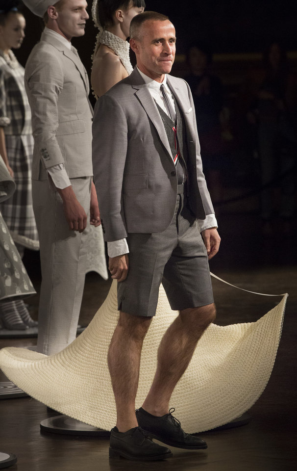 Photo -   Designer Thom Browne greets the audience after his spring 2013 collection was modeled during Fashion Week in New York, Monday, Sept. 10, 2012. (AP Photo/John Minchillo)