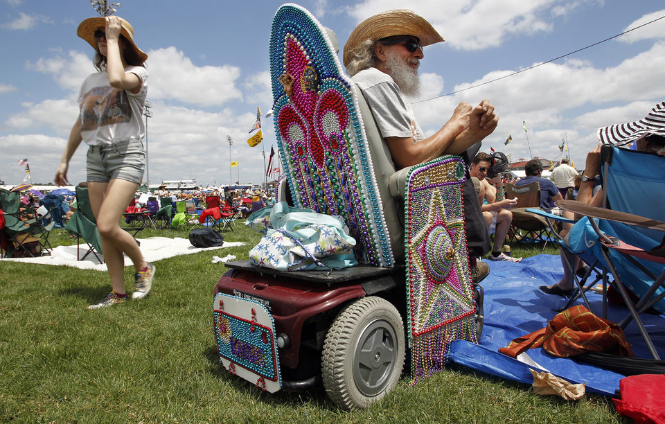 Photo -   David Metzenthin, of Kansas, who has to get around by wheelchair, gets into the New Orleans spirit by covering his wheelchair with Mardi Gras beads for the New Orleans Jazz & Heritage Festival presented by Shell on Friday, April 27, 2012.(AP Photo/The Times-Picayune, Chris Granger) MAGS OUT; NO SALES; USA TODAY OUT