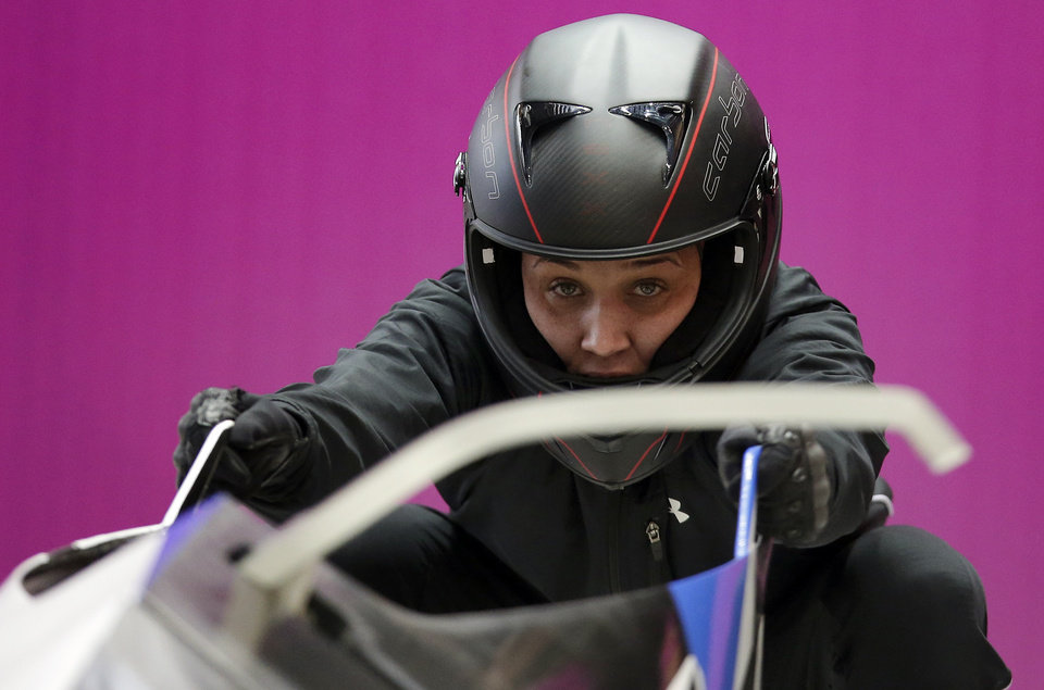 Photo - Breakman Lolo Jones of the United States prepares for a training session with her teammate Jazmine Fenlator for the women's bobsleigh at the 2014 Winter Olympics,  Sunday, Feb. 16, 2014, in Krasnaya Polyana, Russia. (AP Photo/Michael Sohn)