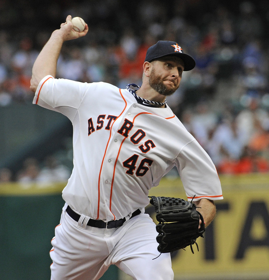 Photo - Houston Astros' Scott Feldman delivers a pitch against the New York Yankees in the first inning of a baseball game Tuesday, April 1, 2014, in Houston, on opening day for the teams. (AP Photo/Pat Sullivan)