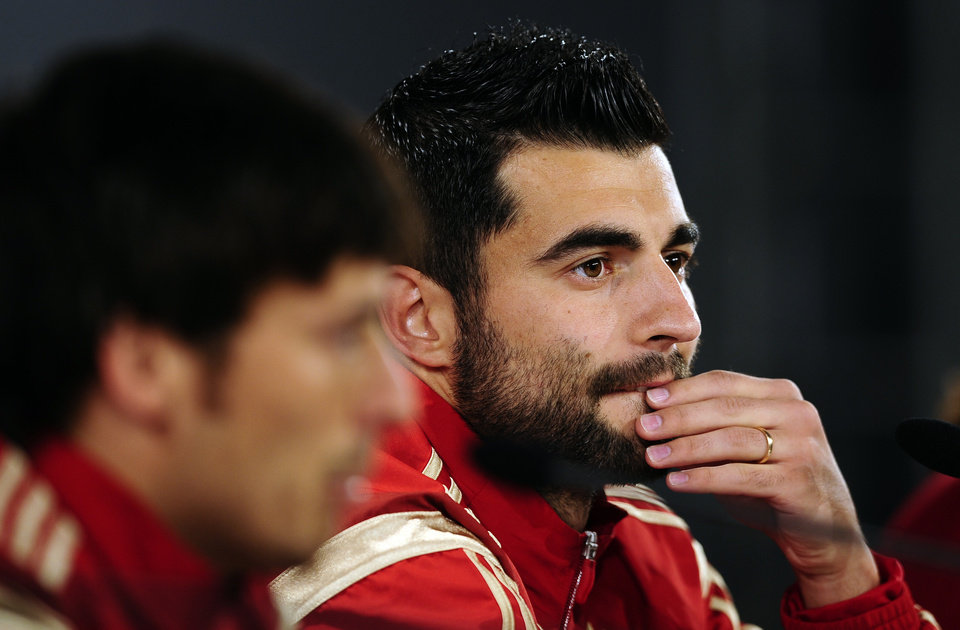 Photo - Spain's Raul Albiol, right, and David Silva, left, attend a press conference of the Spanish national soccer team, at the Atletico Paranaense training center in Curitiba, Brazil, Monday, June 9, 2014. Spain will play in group B of the Brazil 2014 World Cup. (AP Photo/Manu Fernandez)