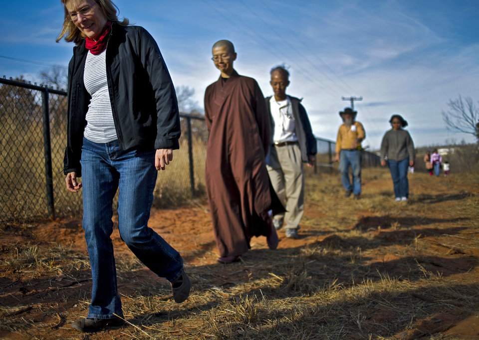 Joan Luh walks with Buddhist nun Jian Jian Shih of the Buddha Mind Monastery on the walking meditation path that is being built around the Oklahoma City  monastery. Photo by Chris Landsberger, The Oklahoman