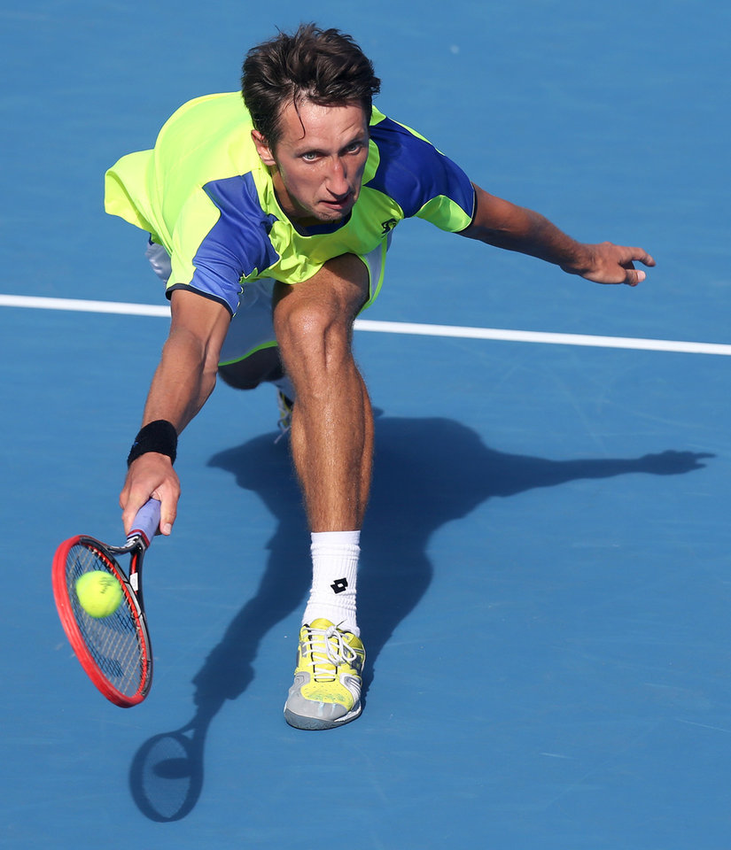 Photo - Sergiy Stakhovsky of Ukraine plays a shot to Australia's Bernard Tomic during their men's singles semifinal match at the Sydney International tennis tournament in Sydney, Friday, Jan. 10, 2014. Tomic won the match 6-7, 7-5, 6-3. (AP Photo/Rick Rycroft)