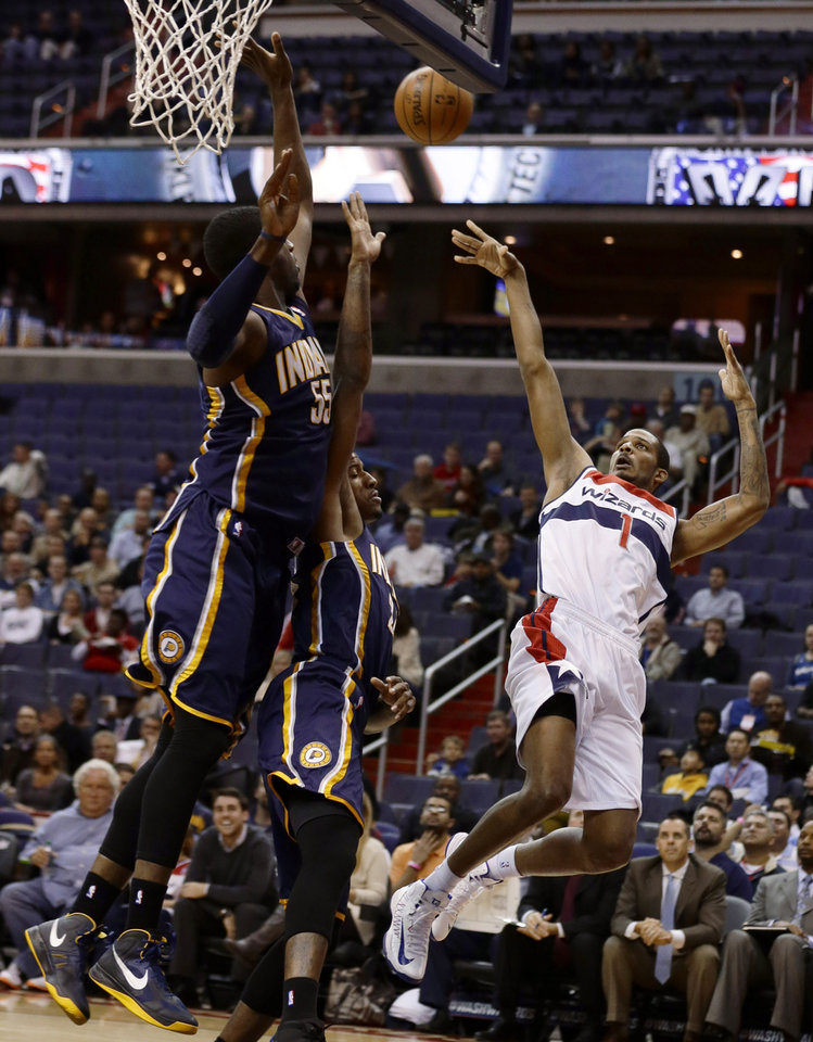 Photo -   Washington Wizards forward Trevor Ariza shoots over Indiana Pacers center Roy Hibbert, left, and forward Paul George in the first half of an NBA basketball game Monday, Nov. 19, 2012, in Washington. (AP Photo/Alex Brandon)