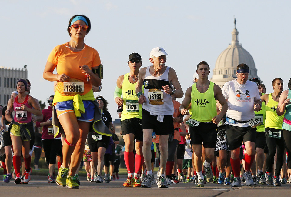 Photo - Runners leave behind the state Capitol as they run north on Lincoln Blvd. during the Oklahoma City Memorial Marathon in Oklahoma City, Sunday, April 28, 2013. Photo by Nate Billings, The Oklahoman