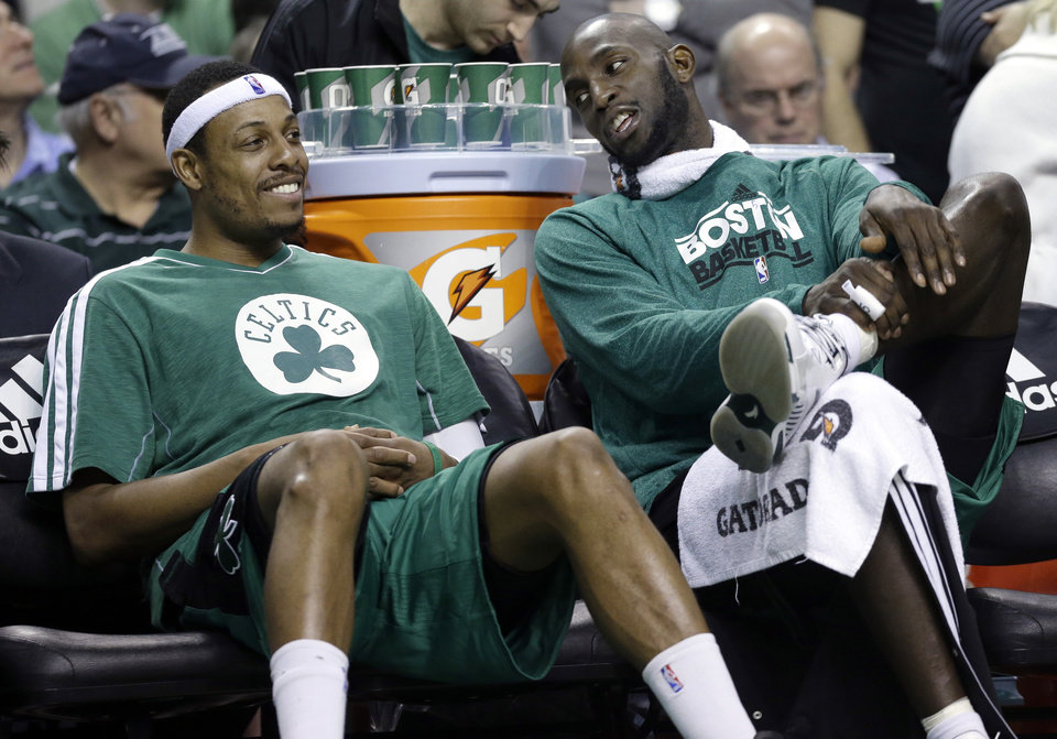 FILE - Boston Celtics center Kevin Garnett, right, chats with teammate Paul Pierce on the bench during the fourth quarter of an NBA basketball game against the Toronto Raptors in Boston, in this March 13, 2013 file photo. The Brooklyn Nets will acquire Paul Pierce and Kevin Garnett from the Boston Celtics in a deal that was still developing as the NBA draft ended, according to a person with knowledge of the details. The trade can't be completed until July 10, after next season's salary cap is set, so pieces were still being discussed early Friday June 28, 2013.  (AP Photo/Elise Amendola, File) ORG XMIT: NY113