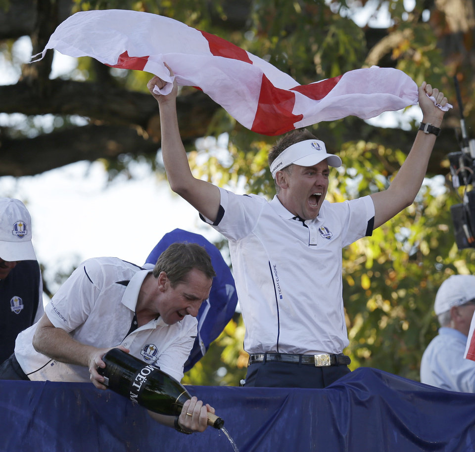 Photo - Europe's Ian Poulter celebrates after winning the Ryder Cup PGA golf tournament Sunday, Sept. 30, 2012, at the Medinah Country Club in Medinah, Ill. (AP Photo/David J. Phillip)  ORG XMIT: PGA223