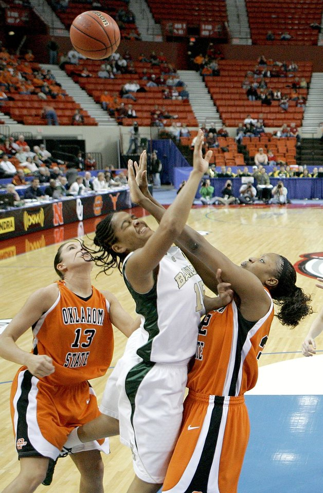 Baylor's Jhasmin Player goes for the ball between OSU's Taylor Hardeman, left, and Shaunte' Smith during the Big 12 Women's Championship game between Oklahoma State and Baylor at the Cox Center in Oklahoma City, Friday, March 13, 2009.  PHOTO BY BRYAN TERRY, THE OKLAHOMAN