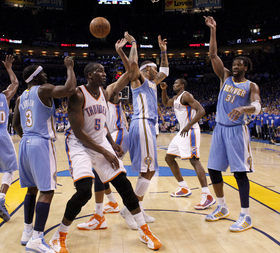 Photo - Oklahoma City's Kendrick Perkins (5) stands between Ty Lawson (3), Kenyon Martin (4), and Nene (31) after a disputed call in the final minutes of the NBA basketball game between the Denver Nuggets and the Oklahoma City Thunder in the first round of the NBA playoffs at the Oklahoma City Arena, Sunday, April 17, 2011. Photo by Bryan Terry, The Oklahoman
