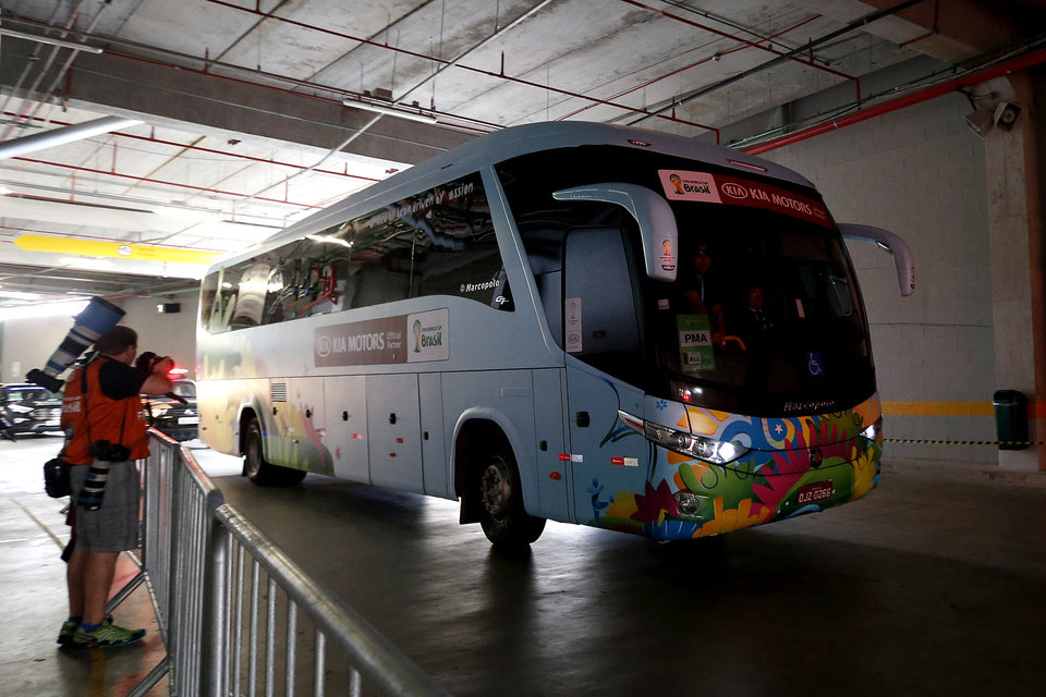 Photo - The United States team bus rolls through a tunnel before an official training session the day before the group G World Cup soccer match between Ghana and the United States at the Arena das Dunas in Natal, Brazil, Sunday, June 15, 2014.  (AP Photo/Julio Cortez)
