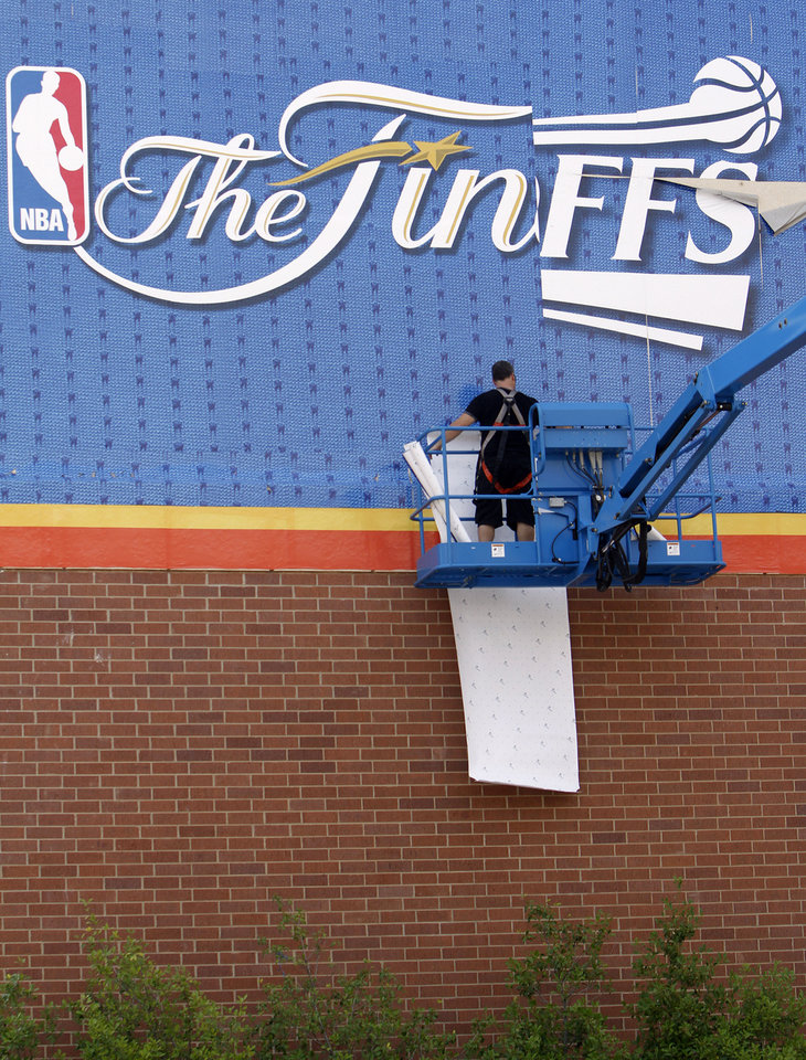 Crews work to hang NBA Finals banners around the Chesapeake Energy Arena on Monday, June 11, 2012, in Oklahoma City, Okla. Photo by Chris Landsberger, The Oklahoman