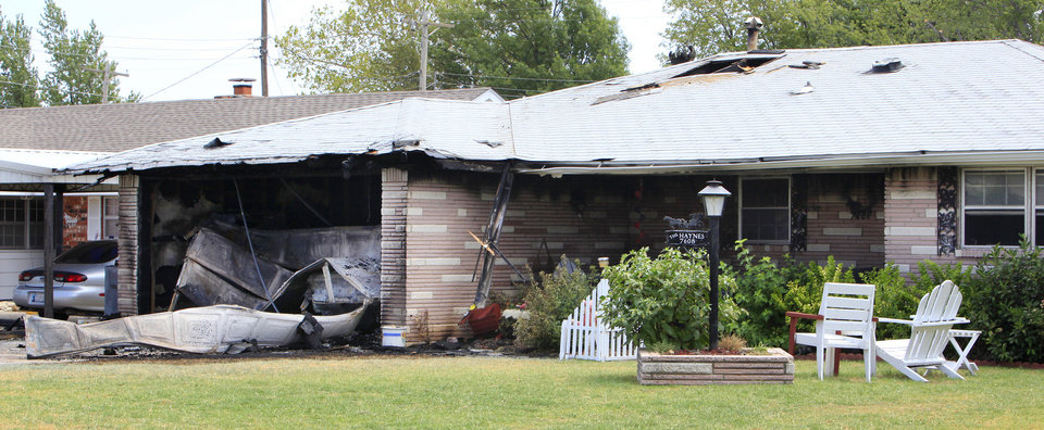 The burned garage of a home at 7608 S Miller Avenue is shown after a possible fire on July 13, 2011, in Oklahoma City. Photo by Paul B. Southerland, The Oklahoman <strong>PAUL B. SOUTHERLAND</strong>