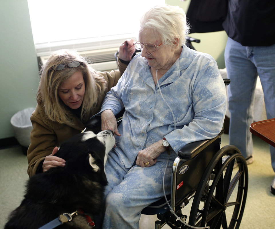 Photo -  Francine Fredrick visits Jake on Feb. 7 with her mother, Joan Mitchell, at the Tuscany Village Nursing Center in Oklahoma City. Photo by Sarah Phipps, The Oklahoman   SARAH PHIPPS -