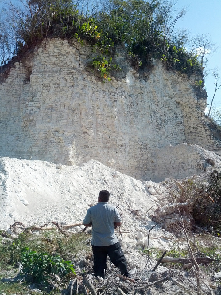 Photo - In this image released by Jaime Awe, head of the Belize Institute of Archaeology on Monday May 13, 2013, a looks at the damaged sloping sides of the Nohmul complex, one of Belize's largest Mayan pyramids on May 10, 2013 in northern Belize. A construction company has essentially destroyed one of Belize's largest Mayan pyramids with backhoes and bulldozers to extract crushed rock for a road-building project, authorities announced on Monday. (AP Photo/Jaime Awe)