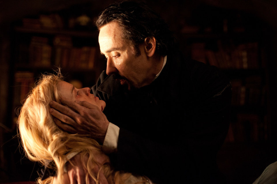 Photo - John Cusack portrays Edgar Allan Poe and Alice Eve plays Emily Hamilton in a scene from the gothic thriller
