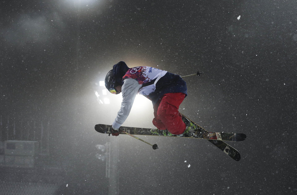 Photo - Gold medalist David Wise of the United States gets air during the men's ski halfpipe final at the Rosa Khutor Extreme Park, at the 2014 Winter Olympics, Tuesday, Feb. 18, 2014, in Krasnaya Polyana, Russia. (AP Photo/Andy Wong)