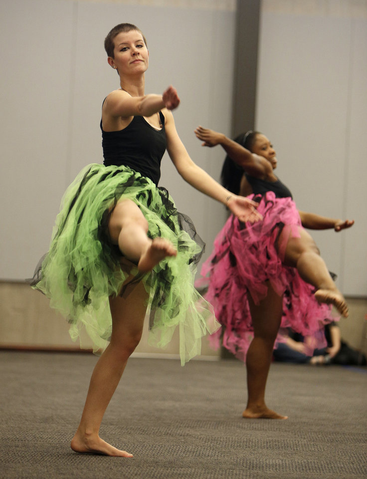 Left: Emily Dawson and Leah Watson, with Perpetual Motion dance company, perform at the Patience S. Latting Northwest Library in Oklahoma City.  Photos by Garett Fisbeck,  The Oklahoman
