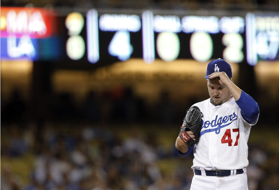 Photo - Los Angeles Dodgers starting pitcher Paul Maholm grabs his cap as he gets taken out in the fourth inning of a baseball game against the Miami Marlins on Wednesday, May 14, 2014, in Los Angeles. (AP Photo/Alex Gallardo)