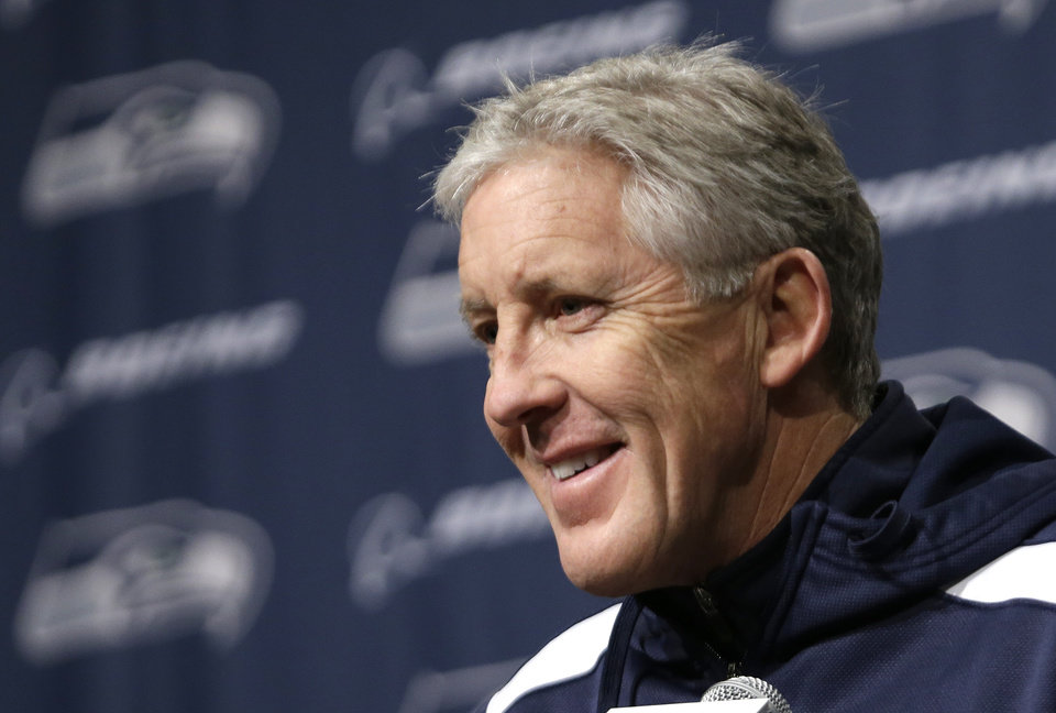Photo - Seattle Seahawks head coach Pete Carroll smiles during an NFL football news conference, Tuesday, Jan. 7, 2014, in Kirkland, Wash. The Seahawks play the New Orleans Saints Saturday in an NFC divisional playoff game. (AP Photo/Elaine Thompson)