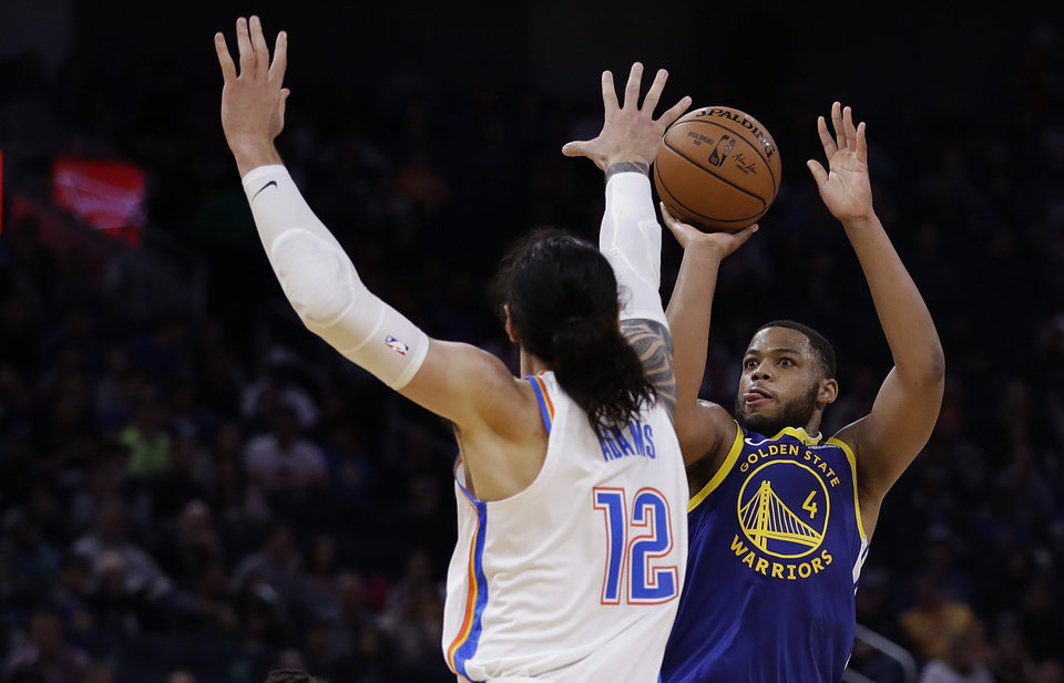 Photo - Golden State Warriors' Omari Spellman, right, shoots against Oklahoma City Thunder forward Steven Adams (12) in the second half of an NBA basketball game, Monday, Nov. 25, 2019, in San Francisco. (AP Photo/Ben Margot)