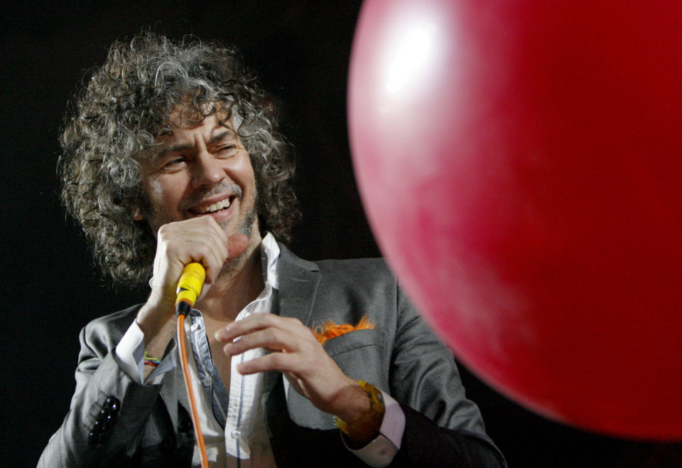 Photo - OPENING NIGHT / CONCERT: Wayne Coyne performs during the Flaming Lips New Year's Eve Freakout at the Cox Convention Center, Friday, Dec. 31, 2010, in Oklahoma City. Photo by Sarah Phipps, The Oklahoman ORG XMIT: KOD