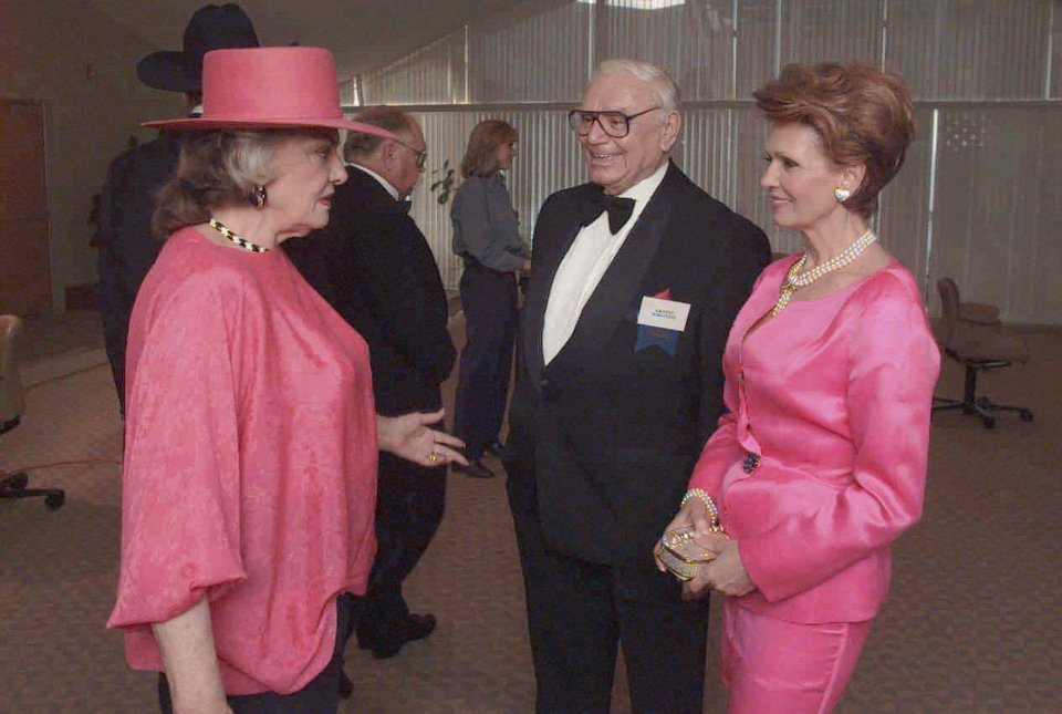 Actress Jane Russell and actor Ernest Borgnine speak before ceremonies at the National Cowboy Hall of Fame.  At right is Tova Borgnine, wife of the actor.