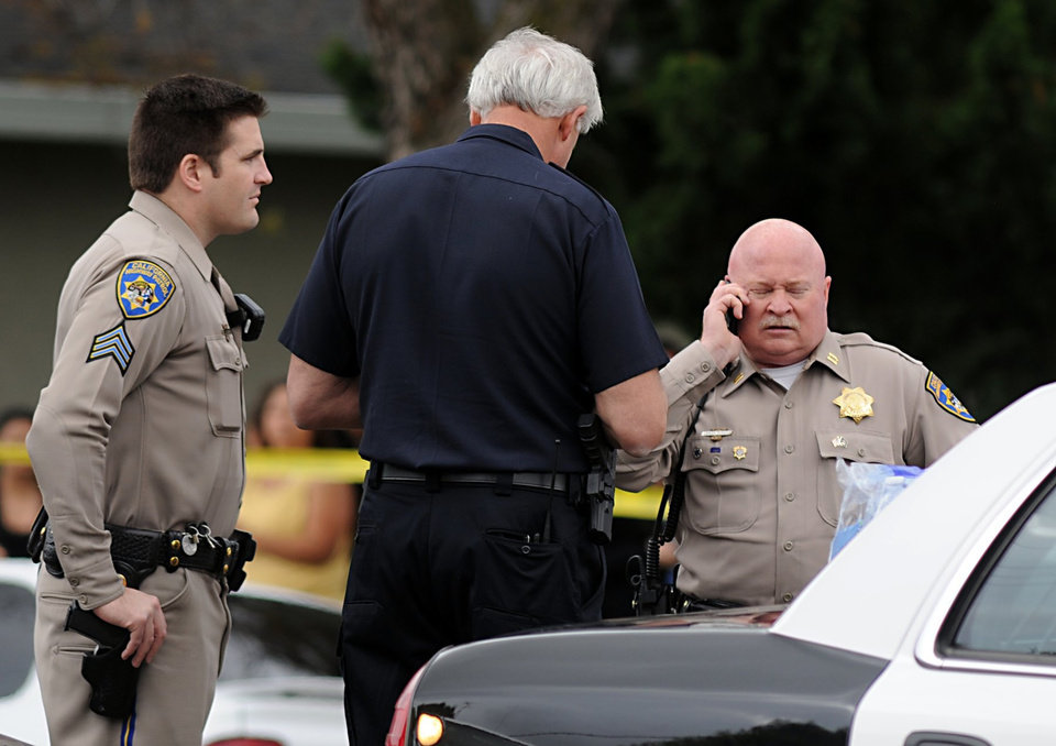 CHP officers are pictured at the scene of an officer involved shooting on Thursday, April 12, 2012 in Modesto, Calif. A sheriff's deputy and a civilian were killed when gunfire broke out as authorities tried to serve an eviction notice at an apartment complex, officials said. (AP Photo/The Modesto Bee, Joan Barnett Lee)