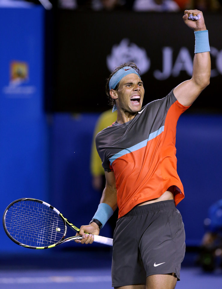 Photo - Rafael Nadal of Spain celebrates after defeating Roger Federer of Switzerland during their semifinal at the Australian Open tennis championship in Melbourne, Australia, Friday, Jan. 24, 2014.(AP Photo/Aaron Favila)
