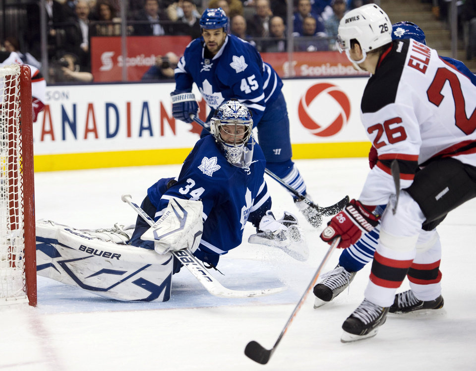 Photo - Toronto Maple Leafs goaltender James Reimer makes a save on New Jersey Devils left wing Patrik Elias (26) during the third period of their NHL hockey game, Monday, March 4, 2013, in Toronto. The Maple Leafs won 4-2. (AP Photo/The Canadian Press, Frank Gunn)