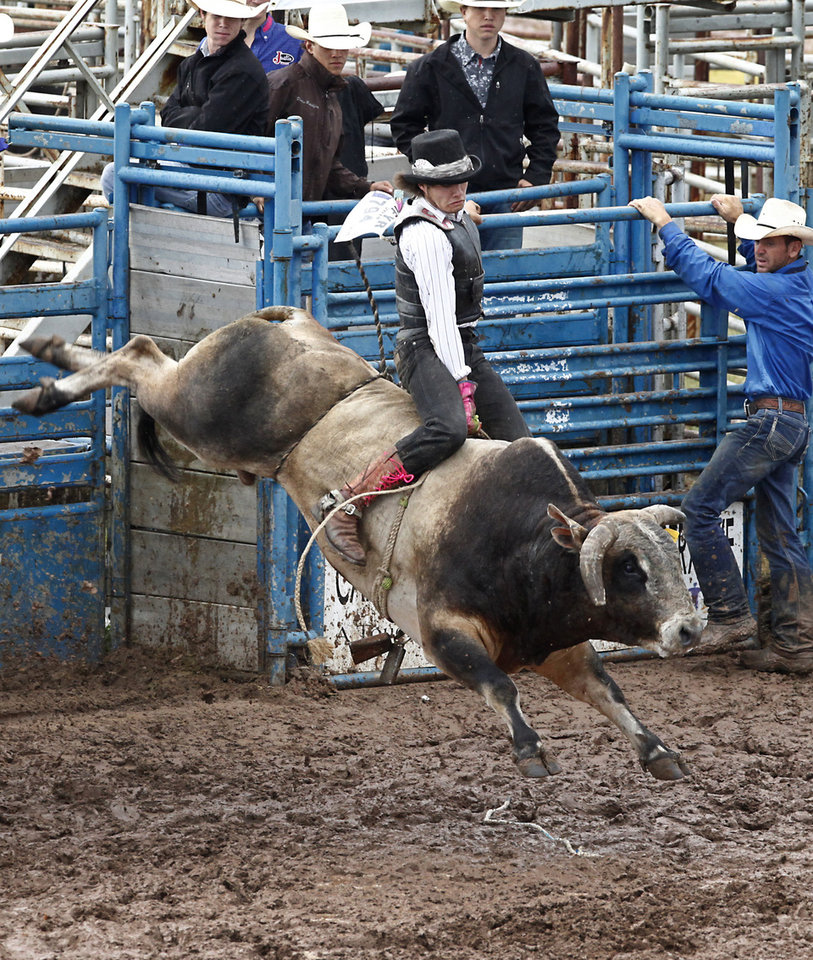 Photo - Shea Russell, Iberia, MO, competes in Bull Riding at the International Youth Finals Rodeo in Shawnee at the Heart of Oklahoma Exposition Center, Wednesday, July 9, 2014. Photo by David McDaniel, The Oklahoman