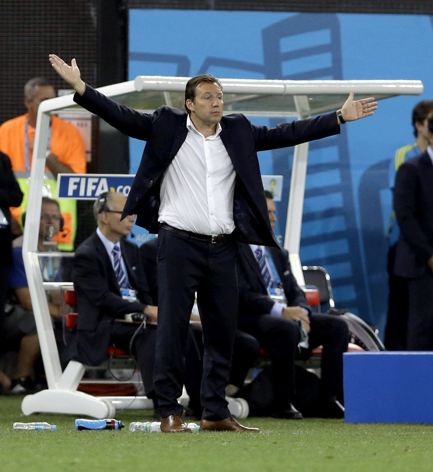 Photo - Belgium's head coach Marc Wilmots reacts during the group H World Cup soccer match between South Korea and Belgium at the Itaquerao Stadium in Sao Paulo, Brazil, Thursday, June 26, 2014. Belgium defeated South Korea 1-0. (AP Photo/Kirsty Wigglesworth)