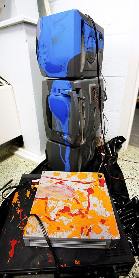 Photo - Stereo and video  recording equipment  in a classroom were splattered with blue, orange and red paint by vandals at Villa Teresa School.  Photo by Paul B. Southerland, The Oklahoman