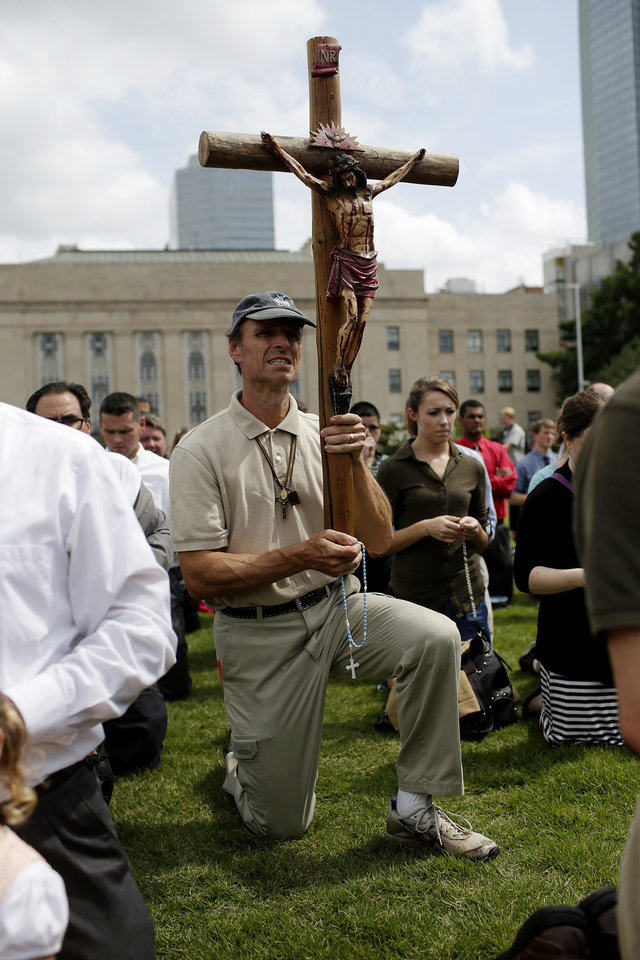 Photo - Richard Mahoney, of Baton Rouge, joins The Society of St. Pius X during a rosary procession in downtown Oklahoma City in protest of the Black Mass, Sunday, Sept. 21, 2014.  Photo by Garett Fisbeck, For The Oklahoman