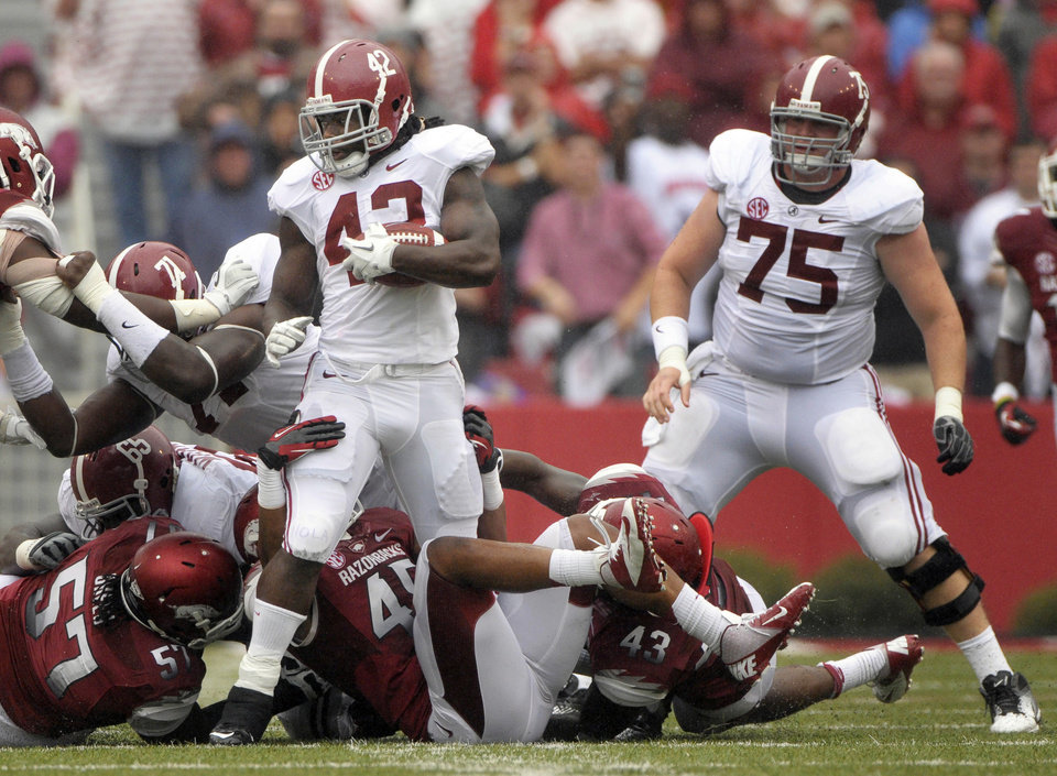 Photo -   Arkansas defensive tackle Jared Green (57) and linebackers Alonzo Highsmith (45), and Tenarius Wright (43) attempt to tackle Alabama running back Eddie Lacy (42) as offensive lineman Barrett Jones (75) looks on during second quarter action of an NCAA college football game in Fayetteville, Ark., Saturday, Sept. 15, 2012. (AP Photo/David Quinn)