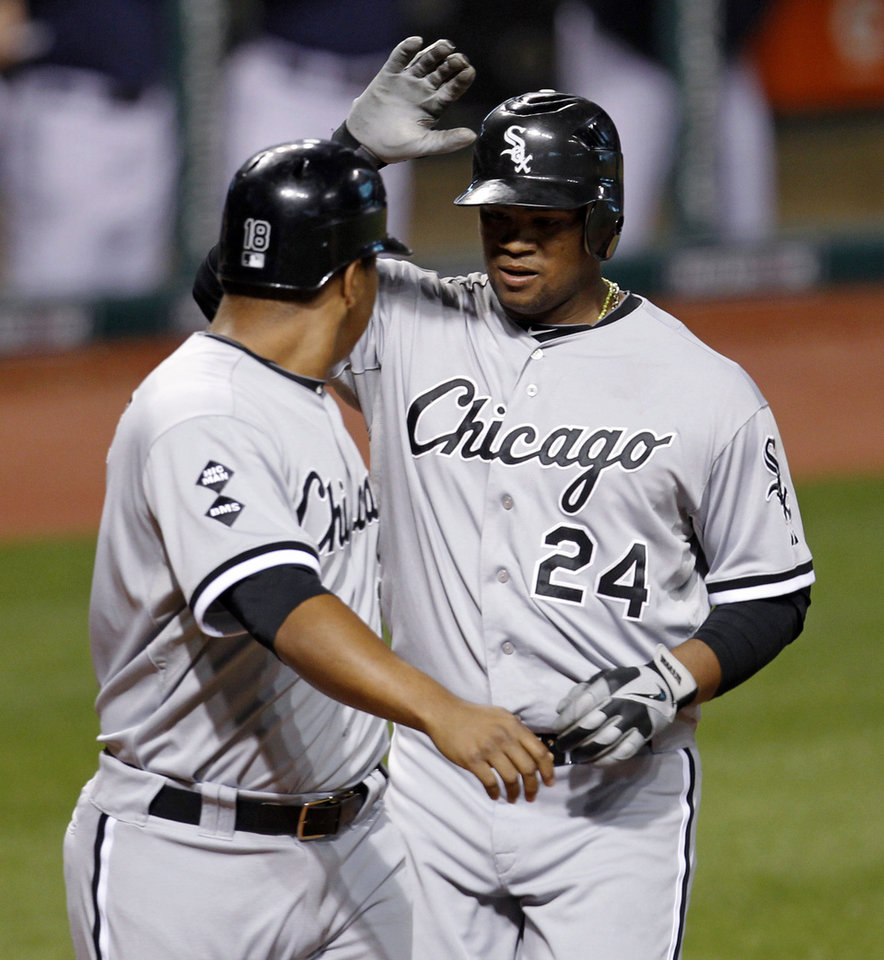 Chicago White Sox's Dayan Viciedo, right, is congratulated by Jose Lopez after Viciedo hit a two-run home run off Cleveland Indians relief pitcher Chris Perez in the ninth inning of a baseball game, Tuesday, Oct. 2, 2012, in Cleveland. Lopez scored on the homer. (AP Photo/Tony Dejak)