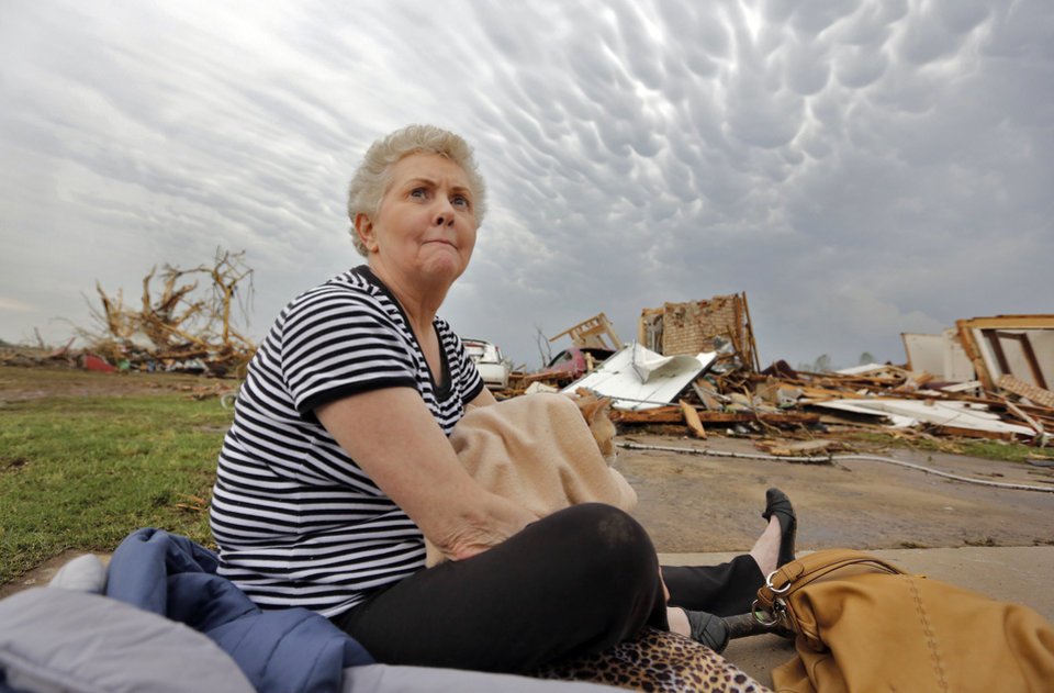 Kay James holds her cat as she sits in her driveway after her home was destroyed by the tornado that hit the area near 149th and Drexel on Monday, May 20, 2013 in Oklahoma City, Okla.  Photo by Chris Landsberger, The Oklahoman
