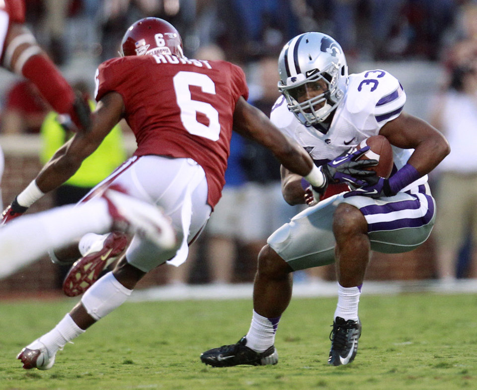 Photo -   Kansas State runing back John Hubert (33) carries as Oklahoma defender Demontre Hurst (6) moves in, during the first quarter of an NCAA college football game in Norman, Okla., Saturday, Sept. 22, 2012. (AP Photo/Sue Ogrocki)