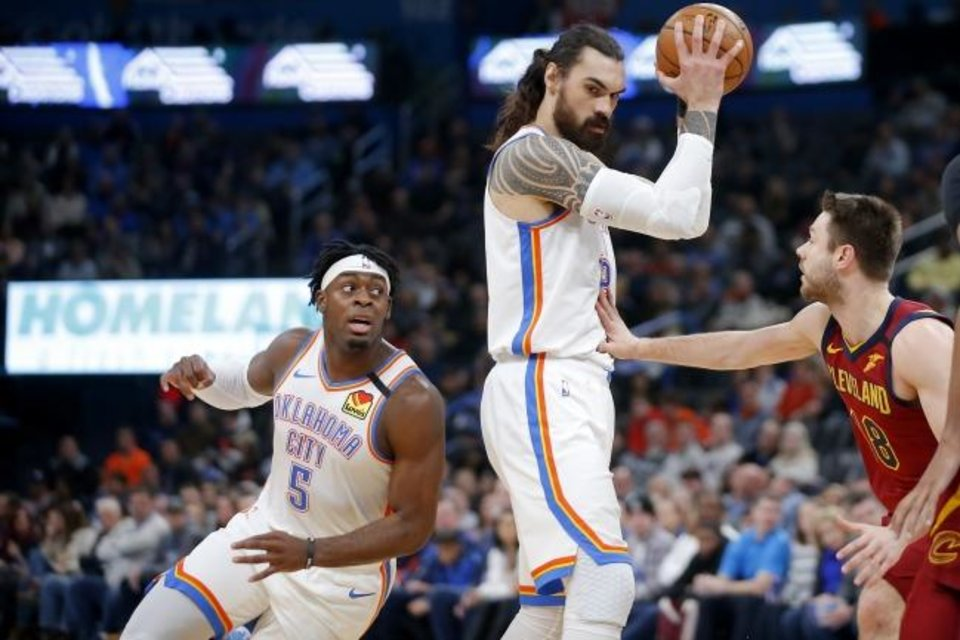Photo -  Luguentz Dort (5) moves behind Steven Adams (12) as Cleveland's Matthew Dellavedova (18) defends during the Thunder's 109-103 win on Feb. 5. [Bryan Terry/The Oklahoman]