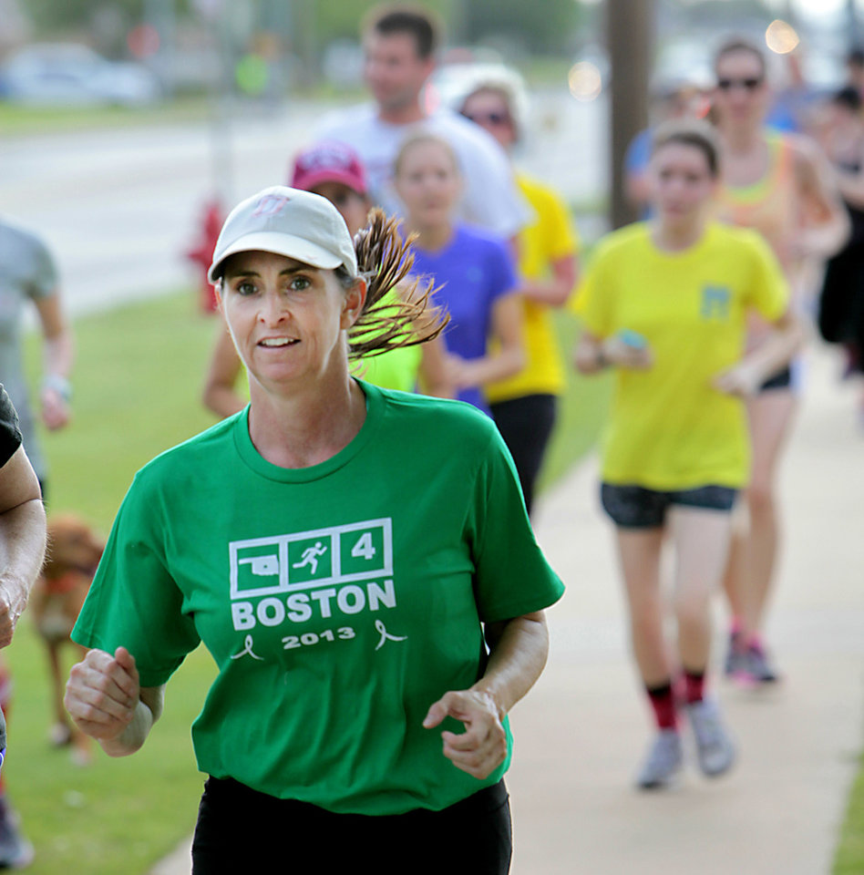 "Photo - Wearing her ""Oklahomans Run 4 Boston"" shirt,  Katheryn Conley takes part Monday in a three-mile run through Edmond."