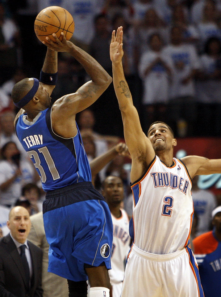 Dallas\' Jason Terry (31) takes the final shot over Oklahoma City\'s Thabo Sefolosha (2) during Game 2 of the first round in the NBA basketball playoffs between the Oklahoma City Thunder and the Dallas Mavericks at Chesapeake Energy Arena in Oklahoma City, Monday, April 30, 2012. Terry missed the shot, and Oklahoma City won, 102-99. Photo by Nate Billings, The Oklahoman