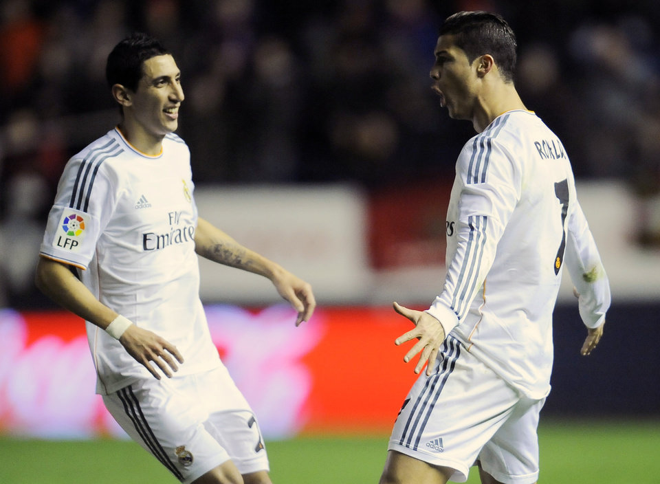 Photo - Real Madrid's Cristiano Ronaldo of Portugal, right, celebrates his goal with his fellow teammate Angel Di Maria of Argentina during their Spanish Copa del Rey round-16 second leg soccer match between Osasuna and Real Madrid at El Sadar stadium, in Pamplona, northern Spain, Wednesday, Jan. 15, 2014. (AP Photo/Alvaro Barrientos)