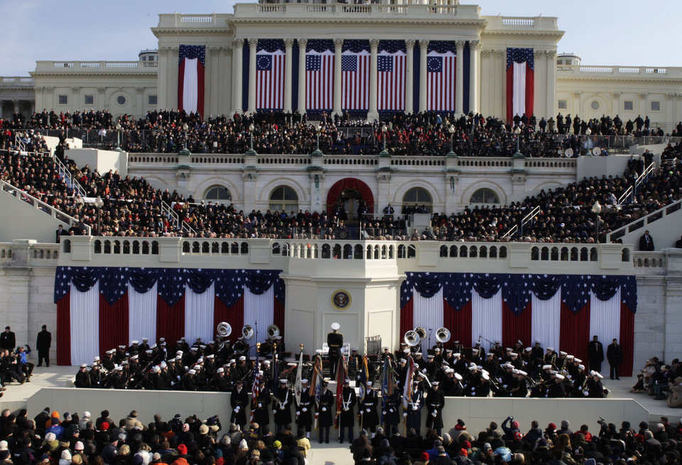 Photo - The stands are filled at the beginning of the inauguration ceremonies for President-elect Barack Obama on Tuesday, Jan. 20, 2009, at the U.S. Capitol in Washington. (AP Photo/Scott Andrews, Pool)