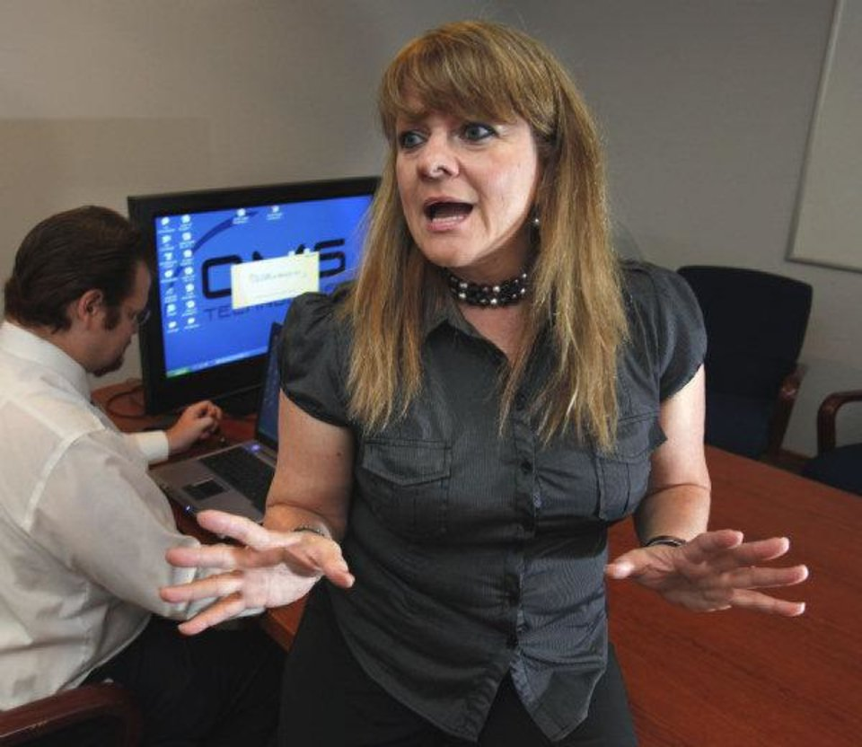 Photo - Agi Lurtz, CEO of OMS Technologies, in her office on Thursday.  STEVE SISNEY - THE OKLAHOMAN