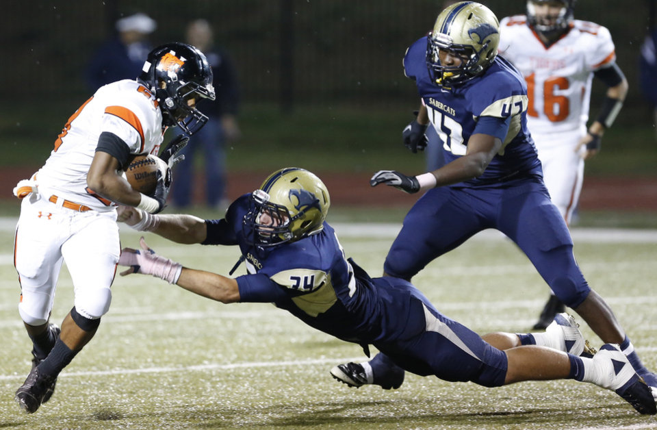 Photo - Norman's Imond Robinson misses Southmoore's Cory Keyes tackle during the first half in Moore, Friday  October 12, 2012. Photo By Steve Gooch, The Oklahoman