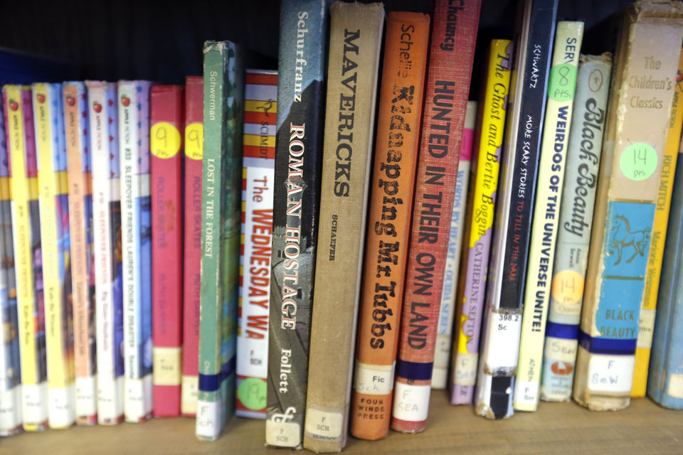 Photo - Books are pictured in the  library, Wednesday, Feb. 13, 2013. Photo by Sarah Phipps, The Oklahoman